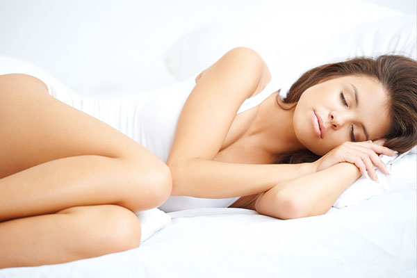Beautiful woman enjoying a peaceful sleep