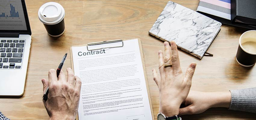 Two people reviewing a contract.