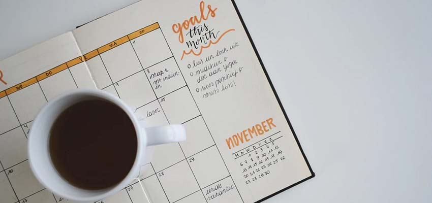 A calendar with a listing of goals.