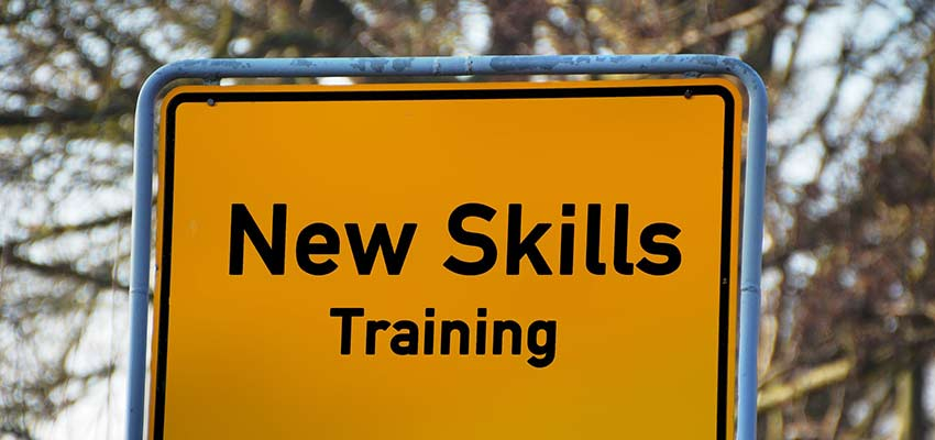 "Sign that reads ""New Skills Training""."