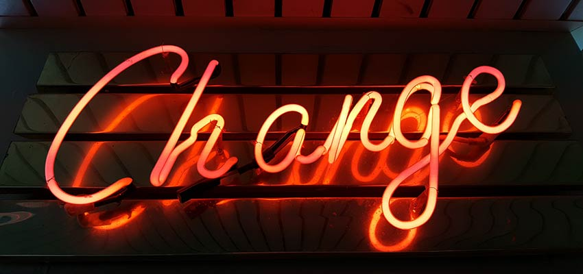 "A neon sign that reads ""Change""."