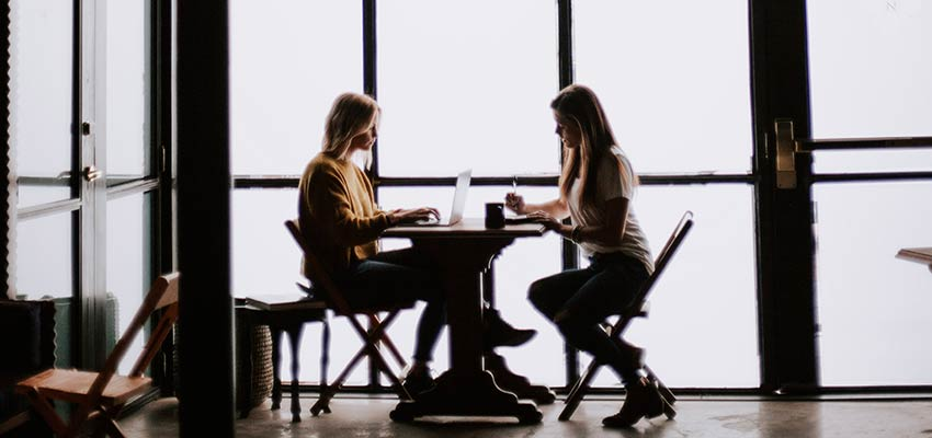 Women sitting at a table.