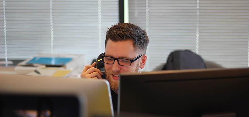 Man talking on a phone.