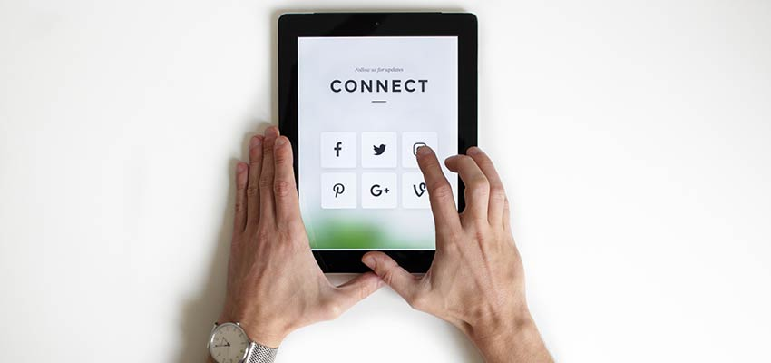 Social media icons on a tablet screen.