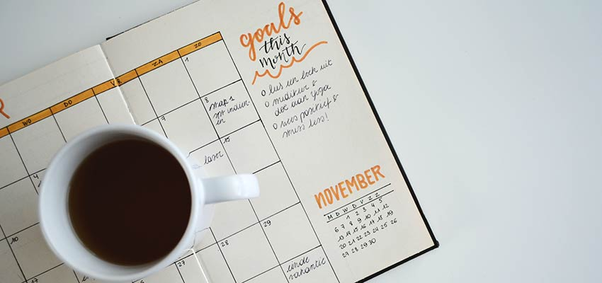 Freelance Design - Desk calendar and coffee cup.